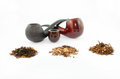 Pipes and tobacco different kinds of isolated on white background Stock Photography