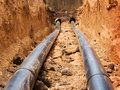 Pipes for water in a trench Royalty Free Stock Photo