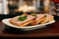 Piquant sandwich with bacon and fennel on the plat plate Royalty Free Stock Image