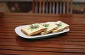 Piquant sandwich with cheese and fennel on the pla plate Stock Photo