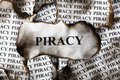 Piracy burnt burnt pieces of paper with the word close up Stock Photo