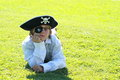 Pirate boy lying on grass Stock Photo