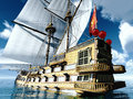 Pirate brigantine out on sea with awesome clouds Royalty Free Stock Images