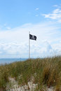 Pirate flag at a baltic sea beach Stock Images