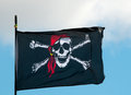 Pirate flag flying in wind Stock Image