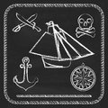 Pirate icons sloop cutlassand jolly roger cutlass and on chalkboard background Stock Images