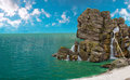 Pirate island huge rock in form of skull on the seashore Stock Photo