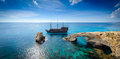 Pirate ship by rock arch cyprus sailing past a in ayia napa Stock Photo