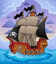 Pirate ship in stormy sea Stock Images