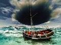 Pirate ship on stormy weather Royalty Free Stock Image