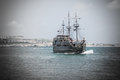 Pirate ship with tourists sailing close to the coast Royalty Free Stock Photo