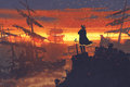 Pirate standing on treasure pile against ruined ships at sunset