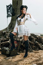 Pirate woman standing near treasure chest beautiful on the beach Stock Photography