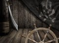 Pirates ship steering wheel with old jolly roger flag scene Royalty Free Stock Image