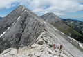 Pirin mountains in Bulgaria, gray rock summit during the sunny day with clear blue sky Royalty Free Stock Photo