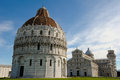 Pisa bapistery the in piazza dei miracoli with the cathedral and leaning tower of in the background in italy Stock Photos