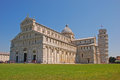 Pisa cathedral with leaning tower during summer time full tourists and visitors Stock Photo