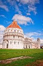 Pisa italy baptistery cathedral and leaning tower in a cloudy day Stock Images