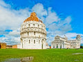 Pisa italy baptistery cathedral and leaning tower in a cloudy day Royalty Free Stock Photography