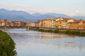 Pisa and river arno floating through the medieval city of italy Royalty Free Stock Images