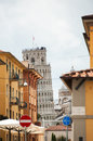 Pisa street and leaning tower the of in the background of a wonderful italian in tuscany italy Royalty Free Stock Photos