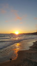 Pismo Beach Sunset with Reflections of Sun off Sand Royalty Free Stock Photo