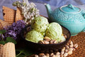 Pistachio ice cream closeup  nuts, lilacs, still life, beautiful Royalty Free Stock Photo