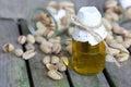 Pistachio nuts oil in a glass bottle