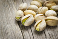 Pistachio nuts on wooden background Stock Image