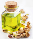 Pistachio oil with nuts Royalty Free Stock Photo
