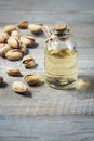 Pistachio oil with nuts. Royalty Free Stock Photo