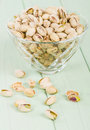 Pistachios roasted and salted pistachio nuts in a glass bowl Stock Photos