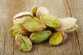 Pistachios on wooden table background Royalty Free Stock Images