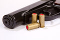 Pistol with ammo isolated black handgun and ammunition on white Royalty Free Stock Photography