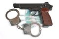 Pistol with handcuffs on money isolated white background Royalty Free Stock Photo