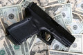 Pistol on money Stock Photo