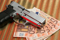 Pistol over euro bills Royalty Free Stock Image
