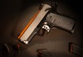Pistol semi automatic handgun that in on a textured gray background Royalty Free Stock Photography