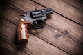 Pistol on a wood background Royalty Free Stock Photos