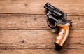 Pistol on a wood background Stock Photography