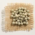 Pea. Close up of grains over burlap. Royalty Free Stock Photo