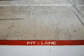 Pit Lane entrance in car competition circuit Royalty Free Stock Photo