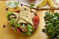 Pita bread stuffed with vegetables and fish selective focus Royalty Free Stock Photos
