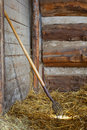 Pitch Fork in Hay in Horse Stall Stock Photo