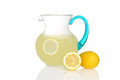 Pitcher of lemonade with fresh lemons on white background Royalty Free Stock Photos