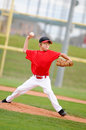 Pitcher in red throwing the pitch. Stock Images