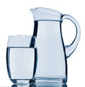 Pitcher of water carafe and a glass symbolic photo for drinking refreshment demand and consumption Stock Photo