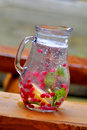 Pitcher of water and fruit infused with herbs Stock Images