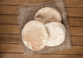 Pitta bread lebanese bread over old burlap background Royalty Free Stock Photography
