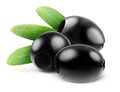 Pitted black olives over white background Stock Photo